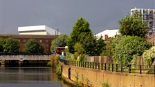 Phase Six: Spotting the Olympic Park - The temporary seating that flanks the Aquatics Centre seen from Three Mills Green