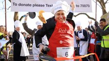 Rehab Parliamentary Pancake Race - The BBC's Ben Wright crosses the line first to take relay race victory, 2015