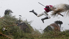 World Press Photo - Grand National Steeplechase - Jockey Nina Carberry flies off her horse by Tom Jenkins, The Guardian