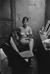 diane arbus: in the beginning - Stripper with bare breasts sitting in her dressing room,Atlantic City, N.J. 1961. Courtesy The Metropolitan Museum of Art, New York / Copyright © The Estate of DianeArbus, LLC. All Rights Reserved