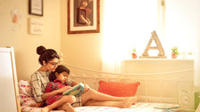 Fujifilm: My Life Exhibition - A self portrait of me reading a story to my daughter on a summer afternoon, by Akanksha Agarwal