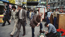 Shot in Soho - William Klein, Shoes polisher, Rocky II, etc, Piccadilly, 1980 © William Klein, courtesy of the artist